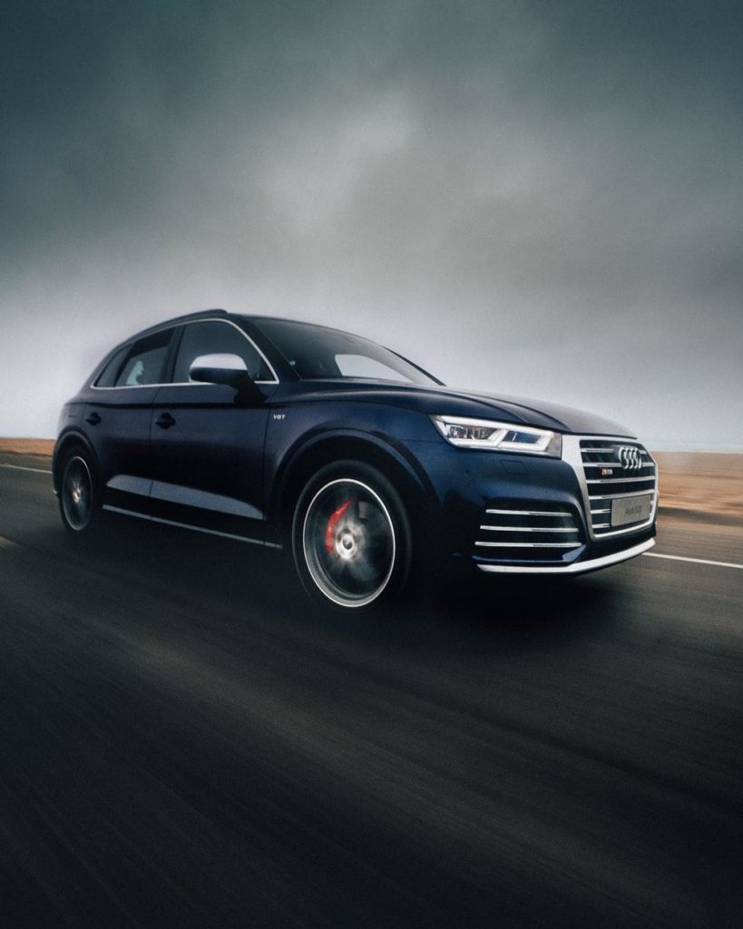 black Audi Q7 SUV on road